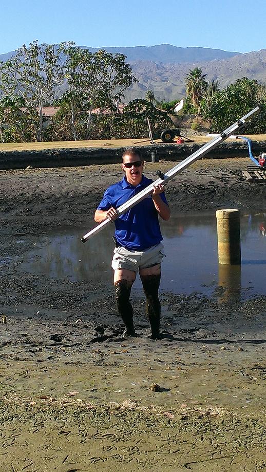 beaty standing in muddy lake